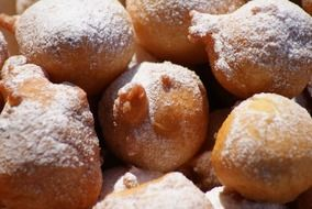 donuts in powdered sugar close-up