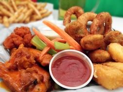 onion rings, chicken wings and sauce
