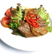 steak with tomatoes and lettuce