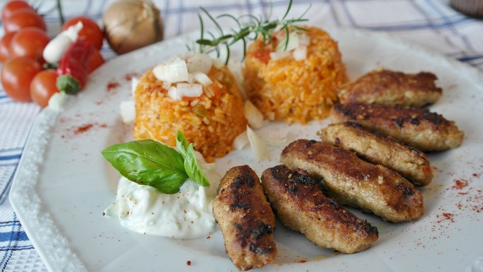 fried cevapcici meat rice and delicious sause