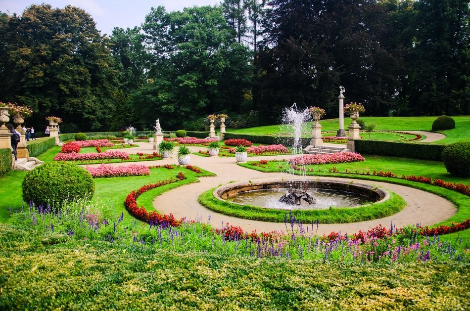fountains and flower beds in the botanical garden
