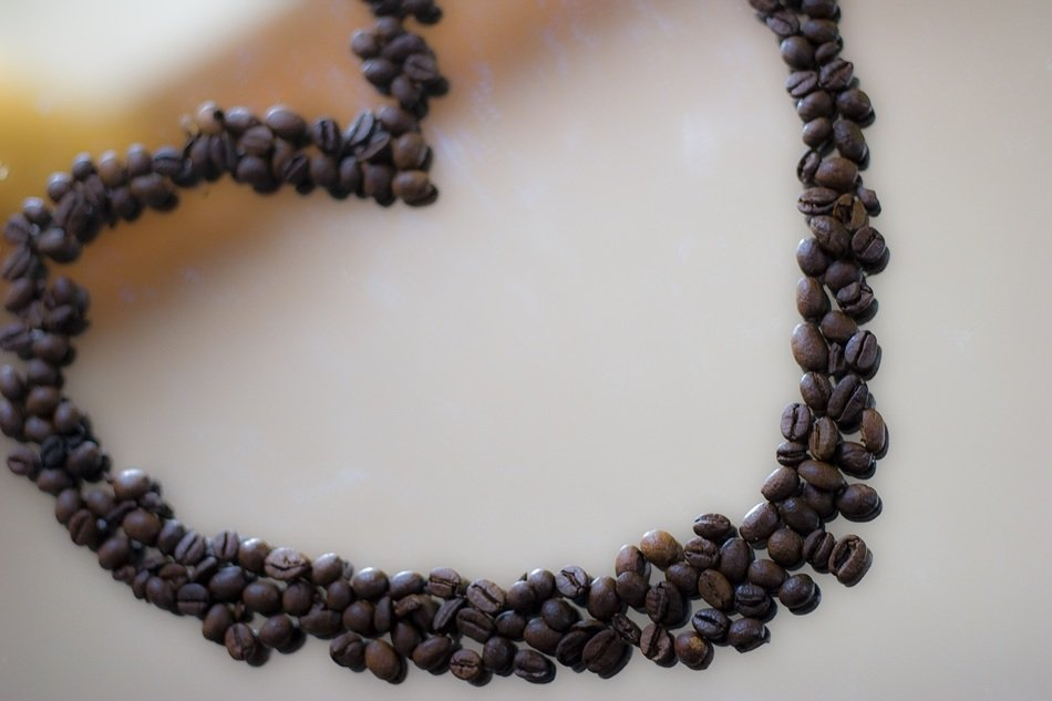 the heart made of coffee beans on the surface