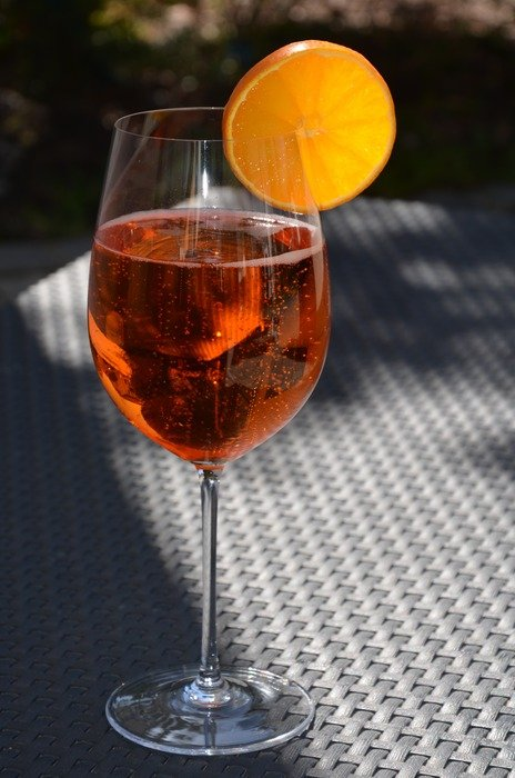 champagne in a glass with orange