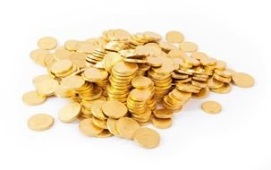 gold coins on a white table