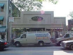 handyman van is parked on the street