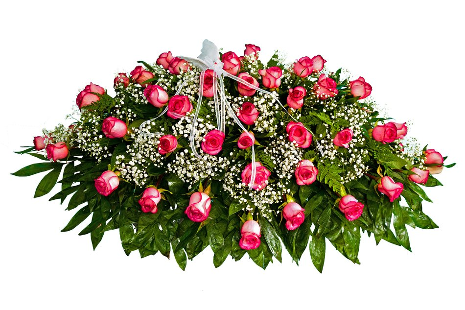 bouquet of pink roses with green leaves and tiny white flowers