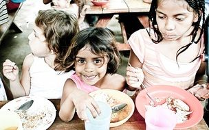 orphans kids eating