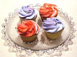 yummy cupcakes with multi-colored cream