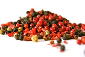 a small pile of dry red and black pepper