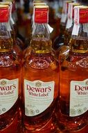 Dewar`s whisky drink alcohol bottles
