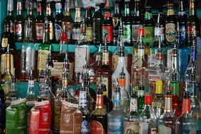 rack with a variety of alcoholic beverages