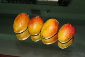 four ripe mangoes