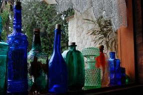 green and blue decorative bottles