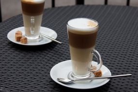 two glasses with latte