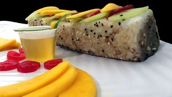 sushi roll with mango slices