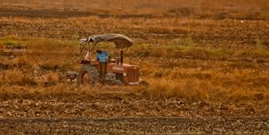 farmer on a tractor on a field