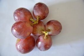 seven grapes-grains on white surface