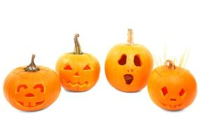 carved pumpkins on a white background