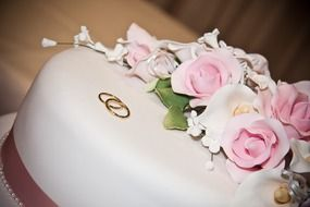 beautiful white wedding cake with rings