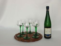 wine bottle and four glasses