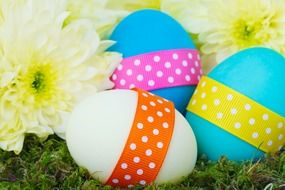 colorful eggs with ribbons for easter