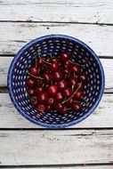ripe cherry in a blue bowl
