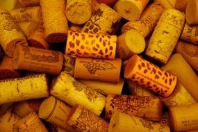 cork from the bottle of wine are in a pile