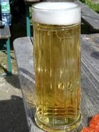 light beer in a tall glass on the table