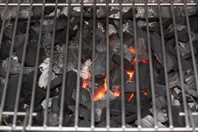 burning coals under the grate