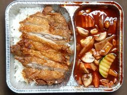 roasted duck with rice and vegetables