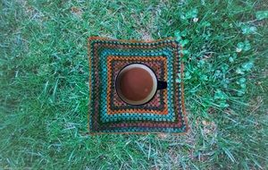 coffee in a cup on green grass