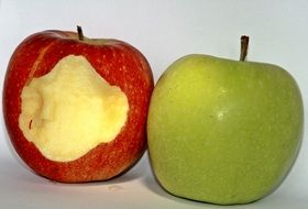 whole apple and a bitten apple
