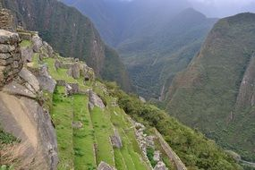 ancient stone steps on mountain side in gorgeous landscape, peru, cuzco