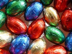 colorful chocolate easter eggs in silver foil