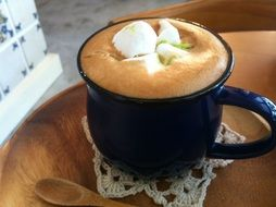blue cup of coffee with marshmallows