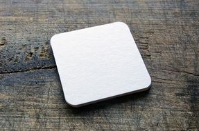 blank beer coaster on the table