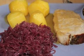 simple dish with potatoes, pork and red cabbage