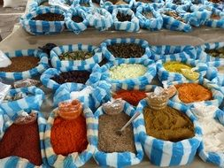 flavored spices in striped bags on the market
