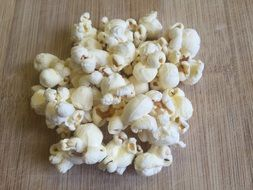 popcorn on a wooden surface