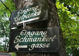 cozy direction signs on tree, germany, bavaria, beer garden