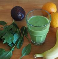 green smoothie with avocado in a glass