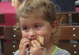 girl is eating a pie