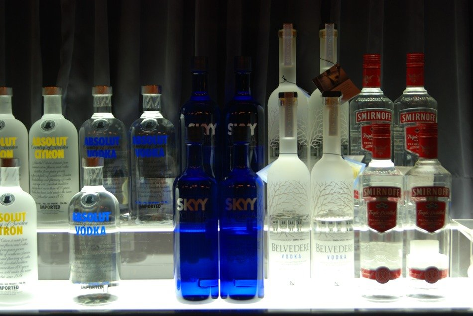 bottles with alcohol drinks in bar