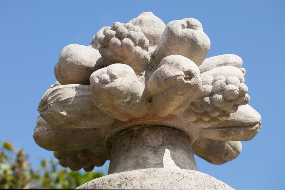 stone sculpture of fruits