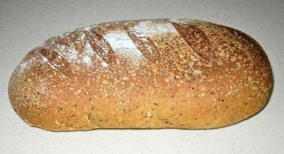 loaf of baked bread with olive oil and oregano