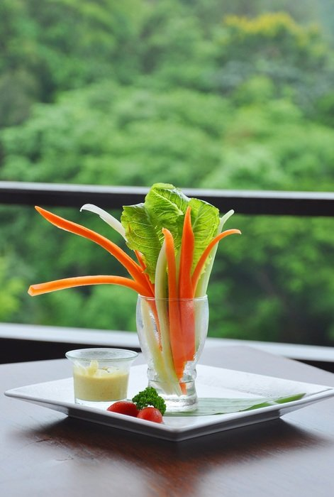 appetizer, delicious salad in glass on table outdoor