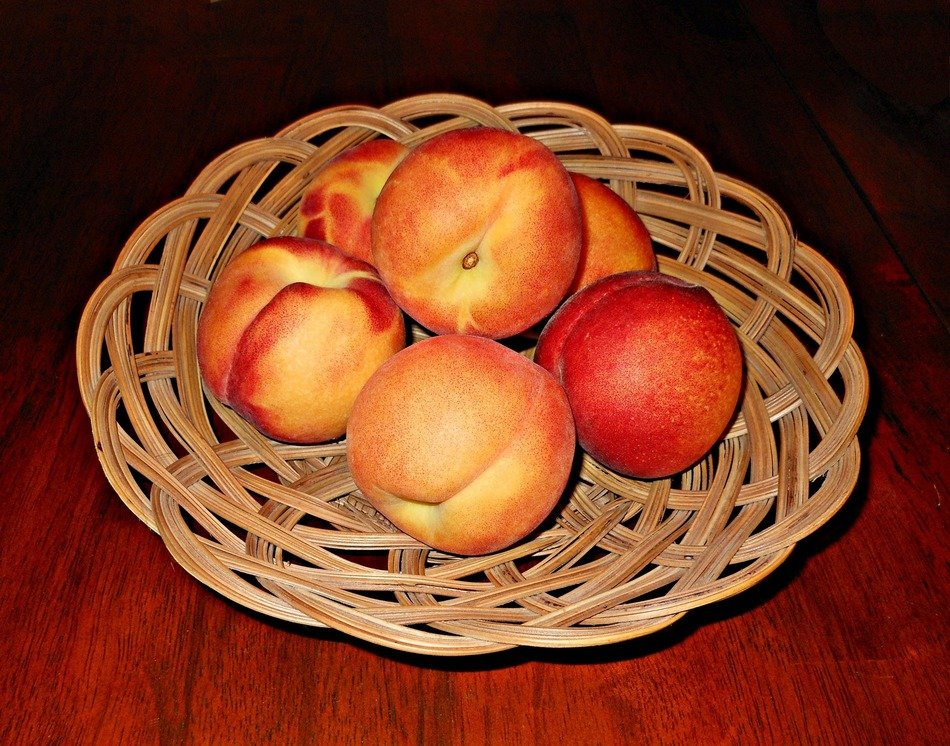 peaches in a wicker basket