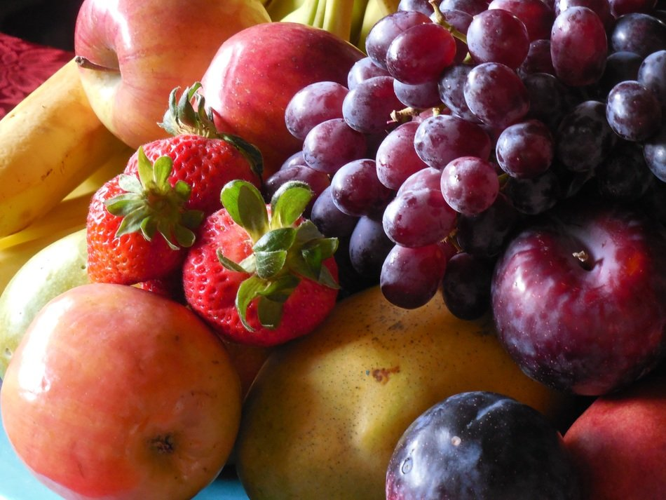 grapes, apples, strawberries and blue plums