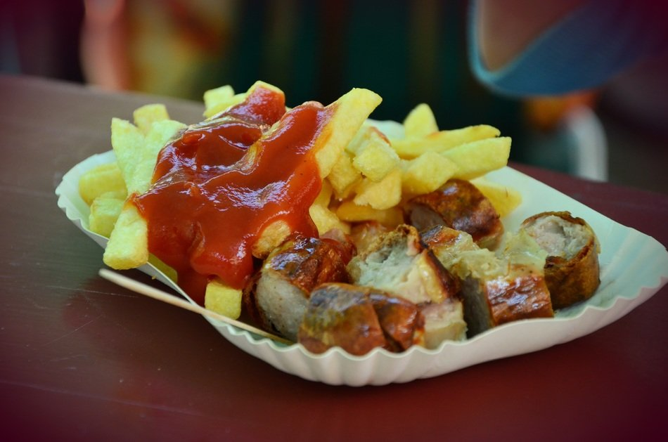 ketchup on french fries and sausage, currywurst