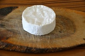 Round White camembert cheese on wooden board